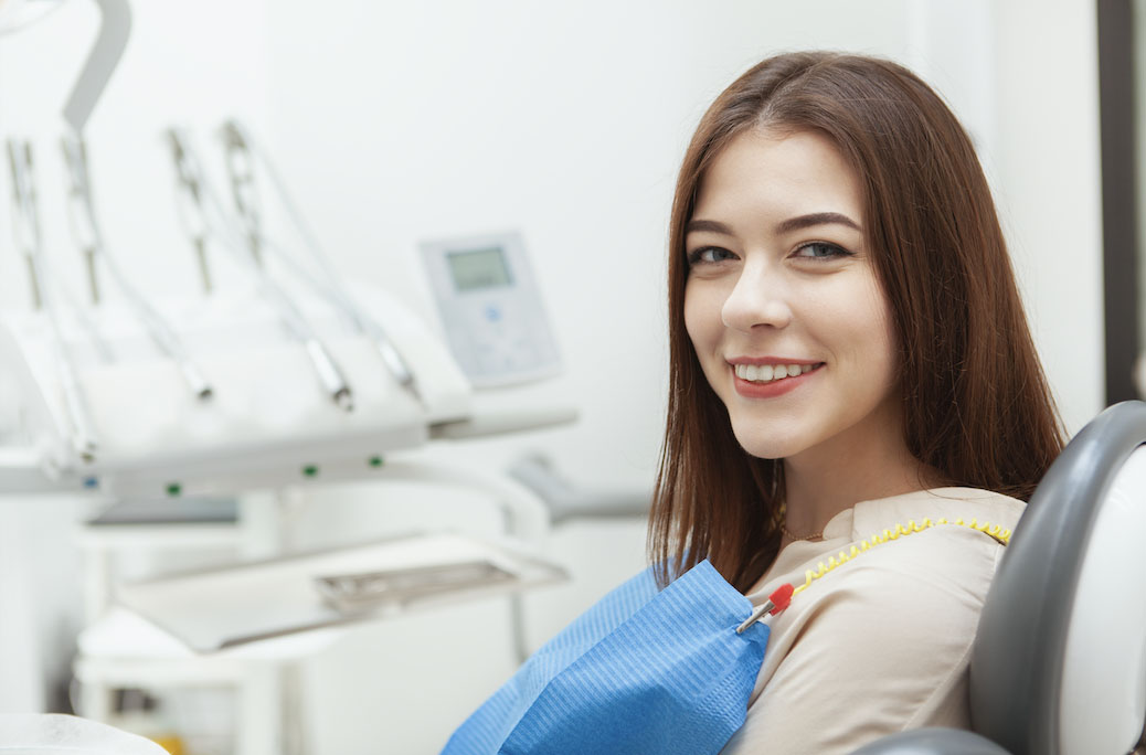 A dental patient looking reassured and comfortable in a relaxed atmosphere.