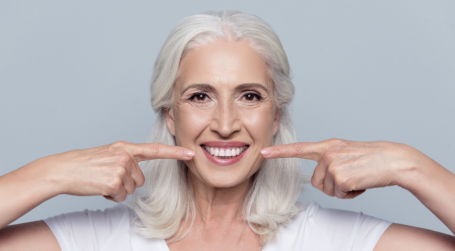 An older lady with white and beautiful teeth proving anyone can achieve a whiter smile.