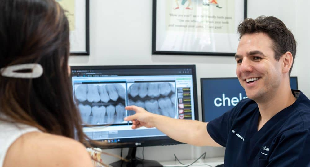 Dentist showing x-ray result to patient